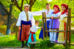 Happy ukrainian family in traditional costumes together in spring garden Royalty Free Stock Photos