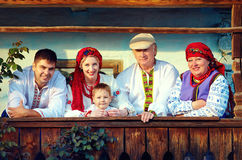 Happy ukrainian family on the wooden porch Stock Image