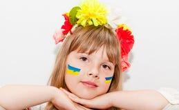 Happy ukrainian girl. Happy teen ukrainian girl with hands near face Royalty Free Stock Image