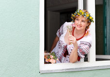 Happy Ukrainian woman in the window Royalty Free Stock Photo