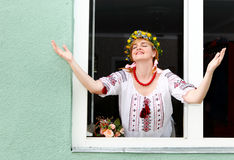 Happy Ukrainian woman in the window Stock Photo