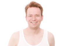 Happy underclothes. Young happy man in a fine rib vest or as the americans call it a wifebeater - isolated on white and retouched Stock Images