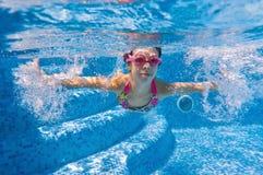 Happy underwater kid in swimming pool Stock Photo