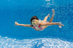 Happy underwater kid in swimming pool Royalty Free Stock Photography