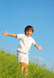 Happy unforgetable childhood. On green meadow against blue sky Royalty Free Stock Image