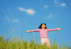 Happy unforgetable childhood on green meadow. Against blue sky Stock Photography