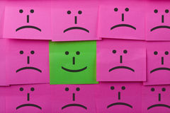 Happy and unhappy concept. Background of Sticky Notes. Stock Images