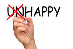 Happy instead unhappy - female hand with marker writing text. On white background stock photos