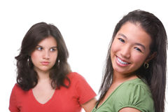 Happy and unhappy female teenagers Stock Image