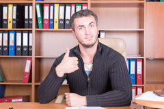 Happy unhappy man in office Royalty Free Stock Photo