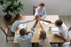Happy united diverse business team people give high five together royalty free stock photo