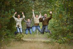 Happy united family. Very happy united family for a walk in the autumn park Royalty Free Stock Photography