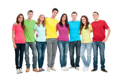 Happy united teenager friends. Portrait of happy smiling group of young friends together isolated on white background stock photography