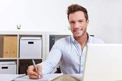 Happy university student learning Stock Image