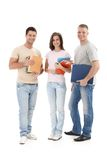 Happy university students. Standing with books and notes handheld, smiling at camera, cutout Stock Photo