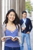 Happy university students outdoors Stock Images