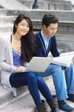 Happy university students. Sitting on a stairs Stock Photography