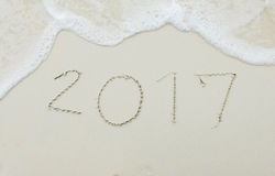 Happy Upcoming New Year 2017 Start with Fresh Concept, Numbers 2017 Handwritten on White Sea Sand Tropical Beach with Ripple Stock Images