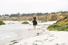 Happy and uplifted woman on a beach royalty free stock photography