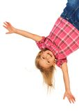 Happy upside down. Happy 4 years old girl hanging upside down isolated on white with smile on her face royalty free stock photo