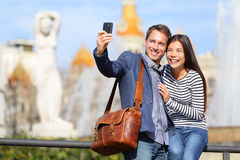 Happy urban city couple on travel in Barcelona Stock Photos