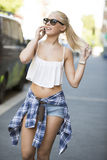 Happy urban young girl talking in the phone Stock Photos
