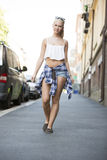 Happy urban young girl walking in the city Stock Image