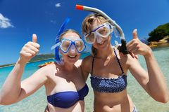 Happy vacation girls with snorkel masks Royalty Free Stock Photography