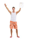 Happy on vacation man in shorts greeting Stock Photo