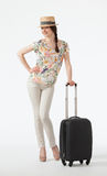 Happy vacation! Playful smiling young woman  with suitcase Royalty Free Stock Images