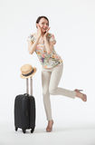 Happy vacation! Playful smiling young woman  with suitcase Stock Image