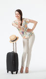 Happy vacation! Playful smiling young woman  with suitcase Royalty Free Stock Photography