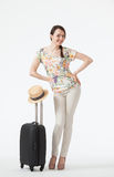 Happy vacation! Playful smiling young woman  with suitcase Stock Photography