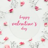 Happy valentine's on white paper card with petal flower. Happy valentine's on white paper card with petal flower on white background.Flat lay.Valentines Royalty Free Stock Images