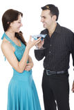 Happy Valentine. Young couple drinking blue cocktails for Valentine Stock Image