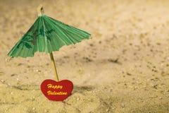Happy Valentine on the beach Stock Photos
