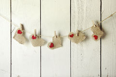 Happy Valentine Burlap Hearts Hanging on a Wood Wall Stock Image