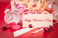 Happy valentine card and Pink alarm clock with bouquet pink rose Stock Photos