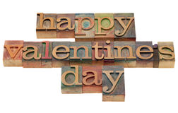 Happy Valentine day. Wishes in vintage wooden letterpress printing blocks, stained by color inks, isolated on white Royalty Free Stock Image