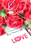Happy valentine day. Beautiful shot of happy valentine day written on diary with rose flowers Royalty Free Stock Image
