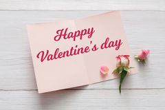 Happy Valentine day card background with flowers on white wood Royalty Free Stock Photo