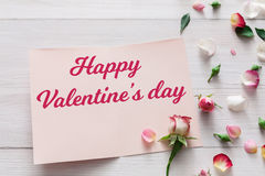 Happy Valentine day card background with flowers on white wood Royalty Free Stock Photos