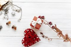 Happy valentine day card concept. stylish red present and heart. And luxury jewelry  accessories on white rustic wooden background. greeting flat lay with space Royalty Free Stock Images
