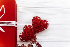 Happy valentine day card concept. stylish red present and heart. On white rustic wooden background. greeting flat lay with space for text Stock Photography
