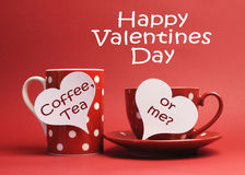 Happy Valentine Day message with Coffee, Tea or Me? written on white heart sign tags. Flirty Happy Valentine Day message with Coffee, Tea or Me? written on white Stock Images