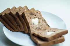 Happy Valentine Day. Photo love bread. bread valentine. photo love delicious slice of bread with strawberry jam sweetener. is suitable for decorating the nuances Royalty Free Stock Image