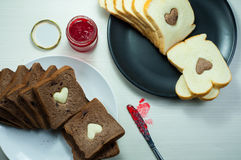 Happy Valentine Day. Photo love bread. bread valentine. photo love delicious slice of bread with strawberry jam sweetener. is suitable for decorating the nuances Stock Images