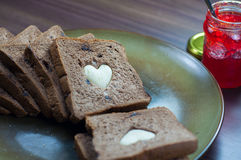 Happy Valentine Day. Photo love bread. bread valentine. photo love delicious slice of bread with strawberry jam sweetener. is suitable for decorating the nuances Stock Photos