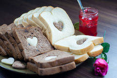 Happy Valentine Day. Photo love bread. bread valentine. photo love delicious slice of bread with strawberry jam sweetener. is suitable for decorating the nuances Stock Photo