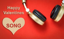 Happy Valentine love songs with headphone on red. Royalty Free Stock Photos
